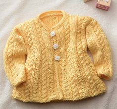 Ravelry: You Are My Sunshine Cabled Baby Cardi pattern by Robin Melanson