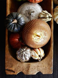 Create a rustic harvest look but filling a dough bowl with pumpkins, real and faux.