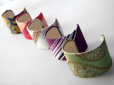 The girls and I made cuffs like this out of toilet paper rolls.  These are covered with old ties.