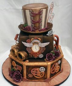 Steampunk cake, look at corset/hat top tier!  Awesome!