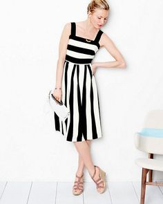 This put-together party dress has grace and a decidedly mod mood. Bold black and white stripes give the ladylike silhouette some graphic punch.