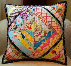 String quilt pillow. super cute with black polka dots as center string.