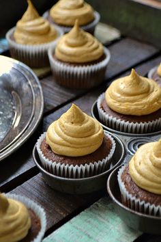 Dark Chocolate Pumpkin Cupcakes filled with Cranberry Curd topped with Molasses Buttercream Frosting