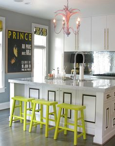 Lisa Sherry Interieurs - fun and funky kitchen. Love the green stools, black/white/gold cabs, and the fun pink chandelier!