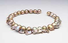 http://blog.pearlparadise.com/wp-content/uploads/2013/07/Copper-green-Fireball-Pearls.jpg
