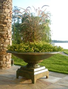 Fountain grass is perfectly suited to this Botanical Gardens Urn.