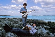 "George Harrison and John Lennon during the filming of ""Help!"" in the Bahamas.Photo taken by Henry Grossman."