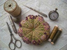 silk ribbon decorated pincushion & old sewing tools