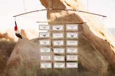 Into the Wild Wedding Inspiration escort cards, kaper chart, seat chart, card hang, seating charts