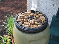 This person has put river rocks on the top of his rain barrel to give it a fountain effect.  Nice.