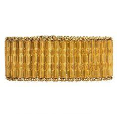 Antique French Gold Bracelet. An antique gold bracelet of beveled and incised links, in 18k. France. France, c 1850