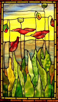 Stained glass window with floral motif seen at the Smith Museum of Stained Glass at Navy Pier in Chicago, Illinois.