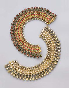 #Desi #Antique #Jewelry ~ A pair of diamond and enamel #Anklets (sanklas) | Mughal or Deccani, late 19th century | Each ankle bracelet designed as a series of flexible pear-shaped links set with table-cut diamonds within foiled gold surrounds to a pear-shaped diamond fringe and seed pearl surmount, the reverse of similar design in red, white and green enamel