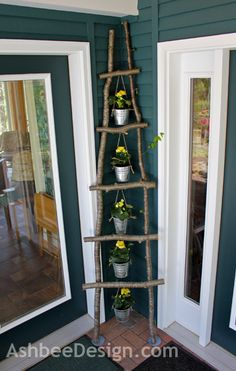 We like this idea to hang small planted pots from this homemade branch ladder for a corner of a patio and porch.