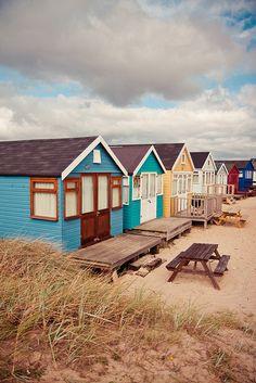 colorful beach huts at mudeford sandbank, new zealand