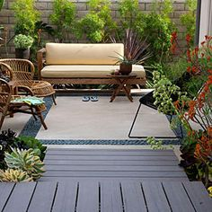 Care-free garden design | Low-fuss decking | Like the stone border in the cement patio... gives the appearance of an area rug... :))   Sunset.com