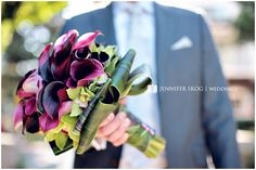 groom with gorgeous calla lilies