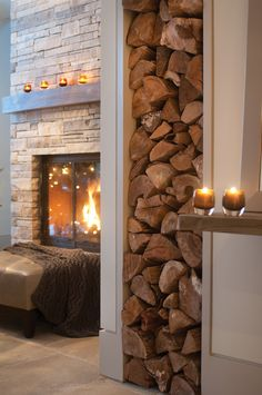 Cozy and pretty. The wood pile adds an artistic element to this space.