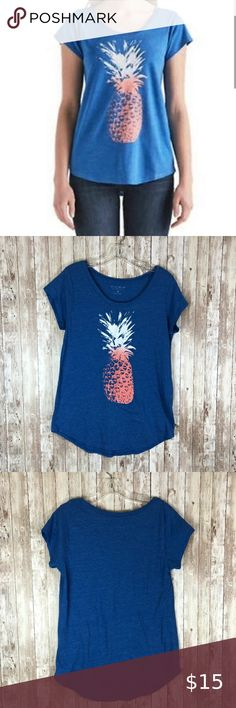 "Lucky Brand Blue Pineapple Lightweight Tee This nice, long lightweight tee from Lucky Brand features a cute little orange and white pineapple on a medium blue background. Perfect for lounging!   Measurements when laid flat: armpit to armpit: 17"" length: 28"" at longest front point bottom opening: 19""  50% polyester/37% cotton/13% Viscose so it has stretch - machine wash cold Lucky Brand Tops Tees - Short Sleeve"