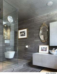 Inspiration from Bathrooms.com: Frameless walk-in shower, off-the-floor furniture and mismatched accessories all say 'confident spa styling'. #bath #bathroom #spa #wetroom