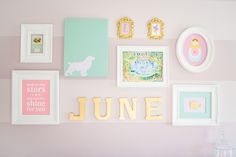 This gallery wall is filled with bright colors and sweet wall art!
