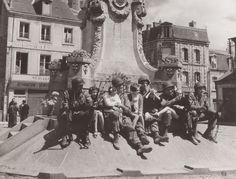 American paratroopers meet children in Carentan, France on June 15, 1944