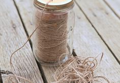DIY Mason Jar Garden Twine Dispenser. Good idea for using in the craft room too.