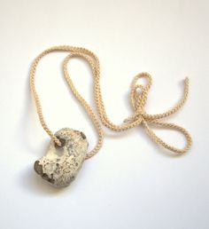 Natural holey beach stone necklace pendant good luck  by astash, $14.00