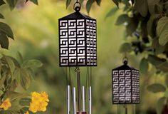 Solar Garden Wind Chimes - Soft wind chimes create romantic movement and sound in the garden. At night, a solar-charged light illuminates the lantern and dangling diamond pendant for an even more enchanting display. Includes one rechargeable AA battery. Some simple assembly.