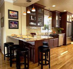 Dark cabinets, light floor.
