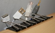 Jumbo Bulldog Folder clips clamped along the edge of whatever place you need your cords.