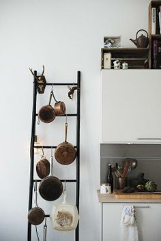 A Ladder Pot Rack- i want to have a ladder drying rack in laundry area for kitchen rags :)