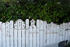 """Pinner wrote: """"The most adorable birdhouse fence, a neighbor built this fence custom with bird houses built onto the pickets, so cute!"""""""