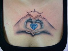 This is my daughter's hands making a heart around a blue diamond. It's on my chest and it's one of my favorite pieces! She gave this to me for my birthday. Tattoo work done by Zack Singer of AETattoo in Dallas, TX.
