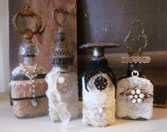 Decorate some old bottle with vintage handles, lace, costume jewelry, brooches and charms.
