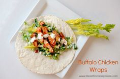 Buffalo Chicken Wraps - quick, easy, and good enough your husband won't be scared to eat a wrap!!
