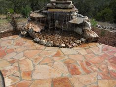 Love this water feature... a pondless waterfall.  SO many possibilities to enhance this!