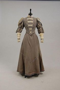 A dove grey faille evening gown, the bodice adorned with cut-steel beads, circa 1893.