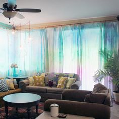 Use a tie dye kit to make a watercolor effect on white curtain panels to give your space a tropical, ethereal look. Video tutorial.