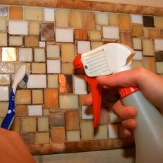 Clean Mold and Mildew    Rid tile and caulk of dark spots by spraying them with vodka. Let sit for up to 30 minutes, scrub with a grout brush or old toothbrush, and rinse thoroughly.