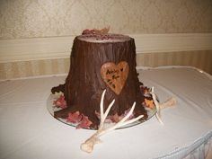 tree stump grooms cake, antlers and leaves are made of sugar paste