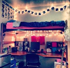 A loft bed with built-in desk in a #dorm room gets some style with lots of white string lights