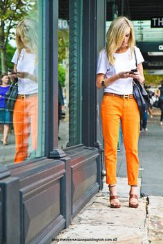 orange pants, white tee.