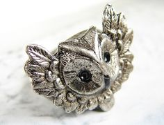 Hey, I found this really awesome Etsy listing at http://www.etsy.com/listing/65198844/metal-owl-ring-statement-animal-ring