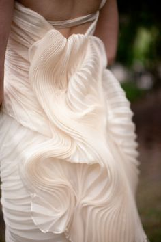 vera wang gown w/cascading pleats.