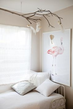 """Sneak Peek: Alice Flynn. """"Walls are painted in a pearlised Porter's Paint finish, which gives the girl's playroom a little bit of zing. The Ikea day bed is perfect for story reading and guests. I wrapped a branch in grey wool and added the birds, which were a special find from a little """"poke about"""" shop in a country town."""""""