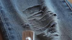 DIY distressed denim...why pay alot of money for those torn up jeans when you can do it yourself :)