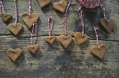 Heart ornaments made from applesauce, cinnamon, and cloves- I imagine these smell wonderful!