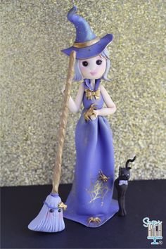 Little witch cake topper ready for Halloween! #fondant #caketopper #cute #gold #sugarhighinc