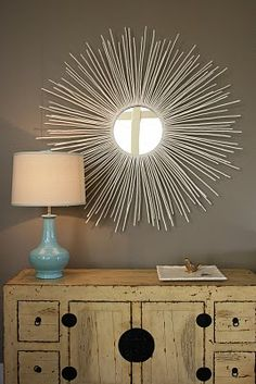 diy sunburst mirror using twigs
